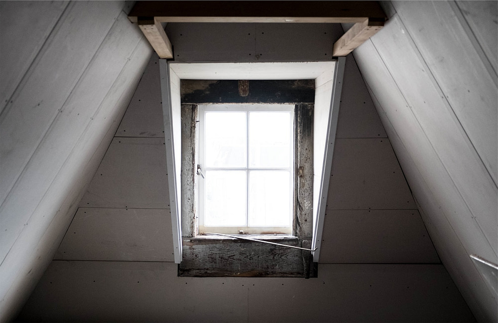 loft window with sloping ceiling