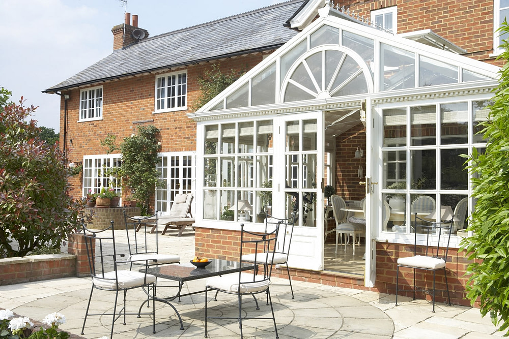 conservatory extension and patio on a brick home